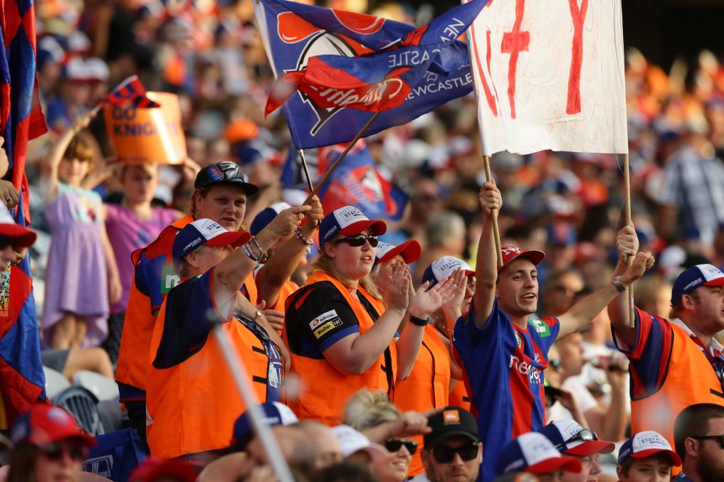 Tradie Town: Newcastle Knights fans during the hi-vis mining round a few years back. As well as Saturday's tradie challenge, there should also be a tradie round, don't you think? Picture: Jonathan Carroll