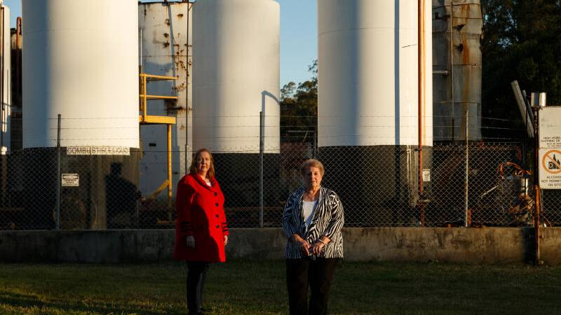 CAMPAIGNERS: State member for Maitland Jenny Aitchison MP, left, and long-time Rutherford resident Ramona Cocco at the Truegain site this week. The Newcastle Herald is using freedom of information laws to find what the EPA is not saying about the seemingly abandoned facility: Picture Max Mason-Hubers