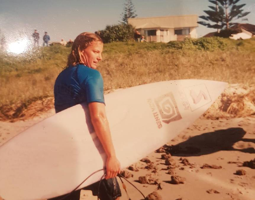 POST-SURF: Kelly Bashford, with a board from one of her sponsors at the time, Hunter brand Kuta Lines.
