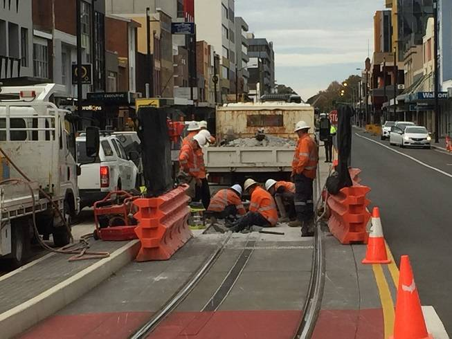 DIGGING IN: Crew working on Hunter Street on Monday afternoon, in the area where the track straightens after coming out of the old rail corridor at Worth Place.