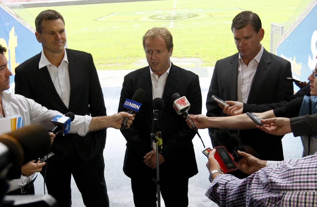 OUSTED: NRL chief executive Dave Smith announces Nathan Tinkler's demise.