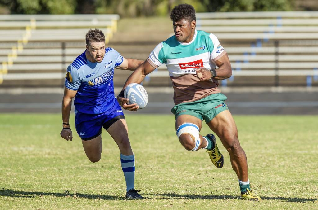 ON THE FLY: Powerhouse Hunter Wildfires winger Nimi Qio burst clear of a Western Sydney defender. Picture: Stewart Hazell