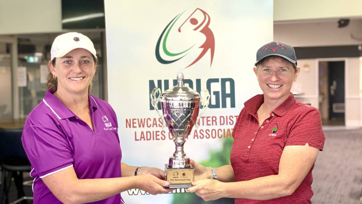 PRIZED POSSESSION: Newcastle Hunter District captain Dom Kelly and Central Coast counterpart Jude Tarran with the NewCoast Cup. Picture: Supplied