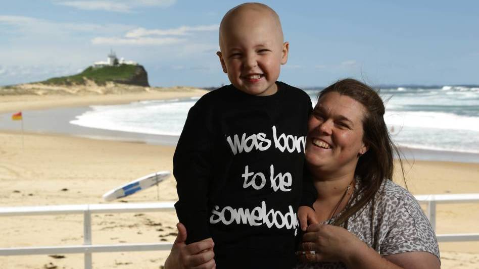 Empathy: Naomi Allen with her four-year-old son Braxton at Nobbys Beach. Ms Allen will shave her head to help ease her son's pain. Pictures: Jonathan Carroll