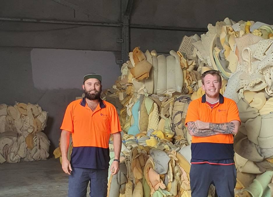 RECYCLING: Soft Landing Newcastle manager Josh Glanville and staff member Ryan Cross. Picture: Supplied