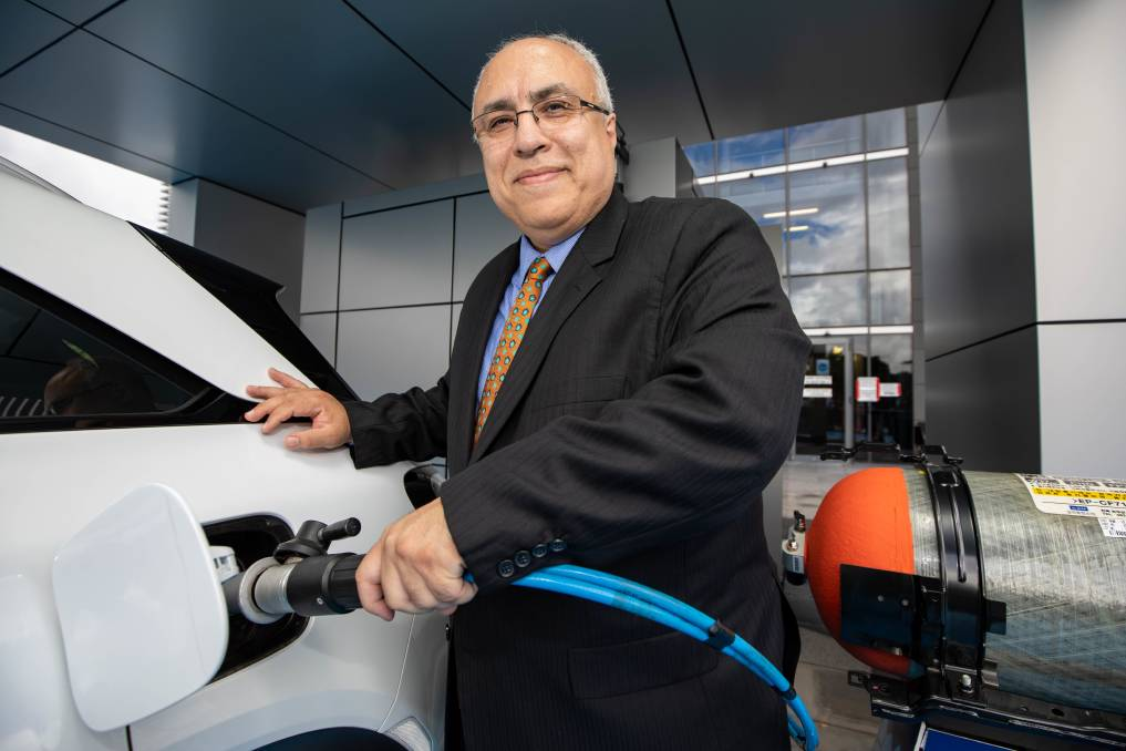 Breakthrough: Professor Behdad Moghtaderi refilling the Hyundai's NEXO hydrogen fuel cell SUV with green hydrogen. Picture: Eddie O'Reilly, University of Newcastle.