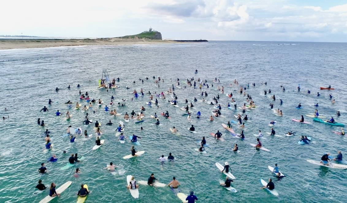 WAVE OF OBJECTION: Surfers took to the water at Nobbys Beach on Sunday to protest against plans for more seismic testing off the coast of Newcastle. Picture: Kailin Pasin