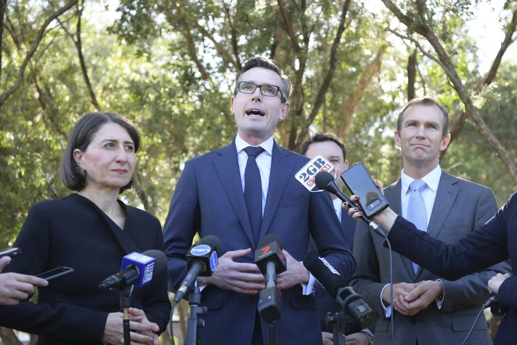 Windfall: Premier Gladys Berejiklian, Treasurer Dominic Perrottet and Minister for Education Rob Stokes say the budget will have $6 billion for new and upgraded schools, plus $160 million for maintenance. Picture: Simon Bullard