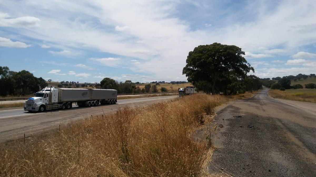 One example of an old highway (right) being retained as a local service road. Photos: Sam Hollier.