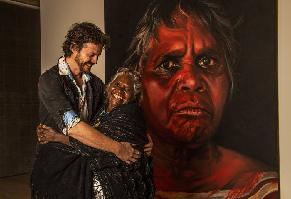 Humbled: Elder Daisy Tjuparntarri Ward and artist David Darcy with his work, Tjuparntarri - women's business. Picture: Louise Kennerley