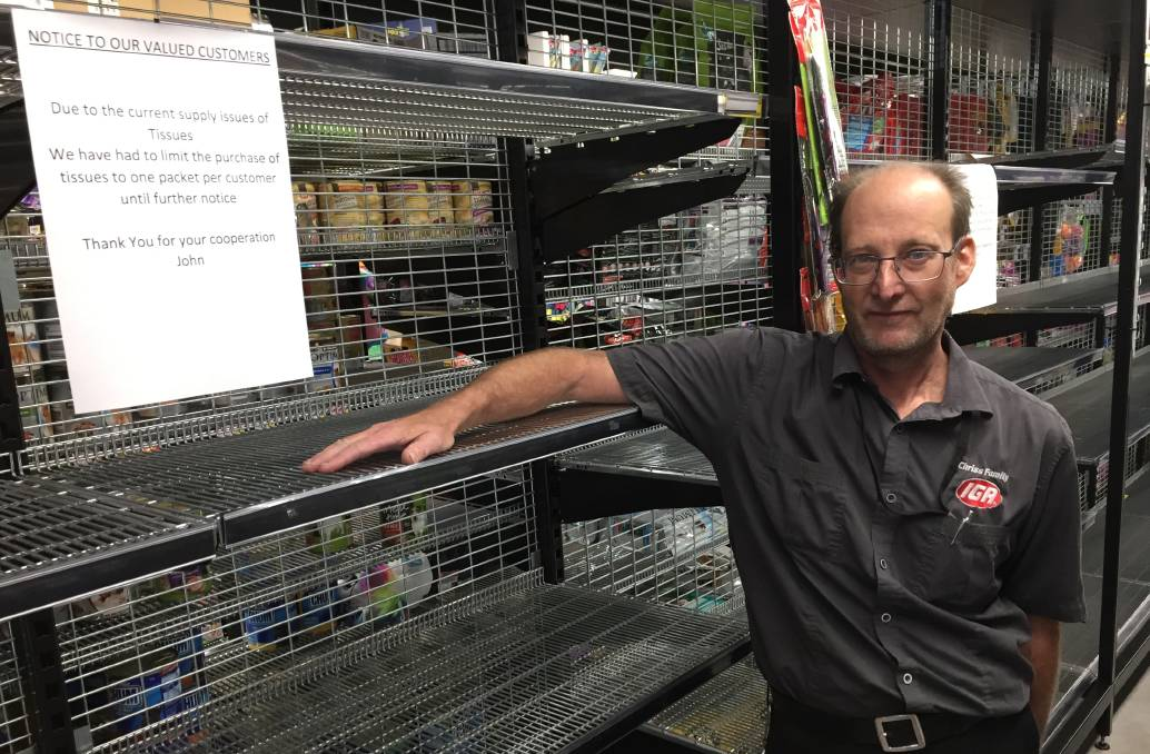 EMPTY SHELVES: Dean Gardner, assistant manager at the IGA supermarket in Wangi Wangi.