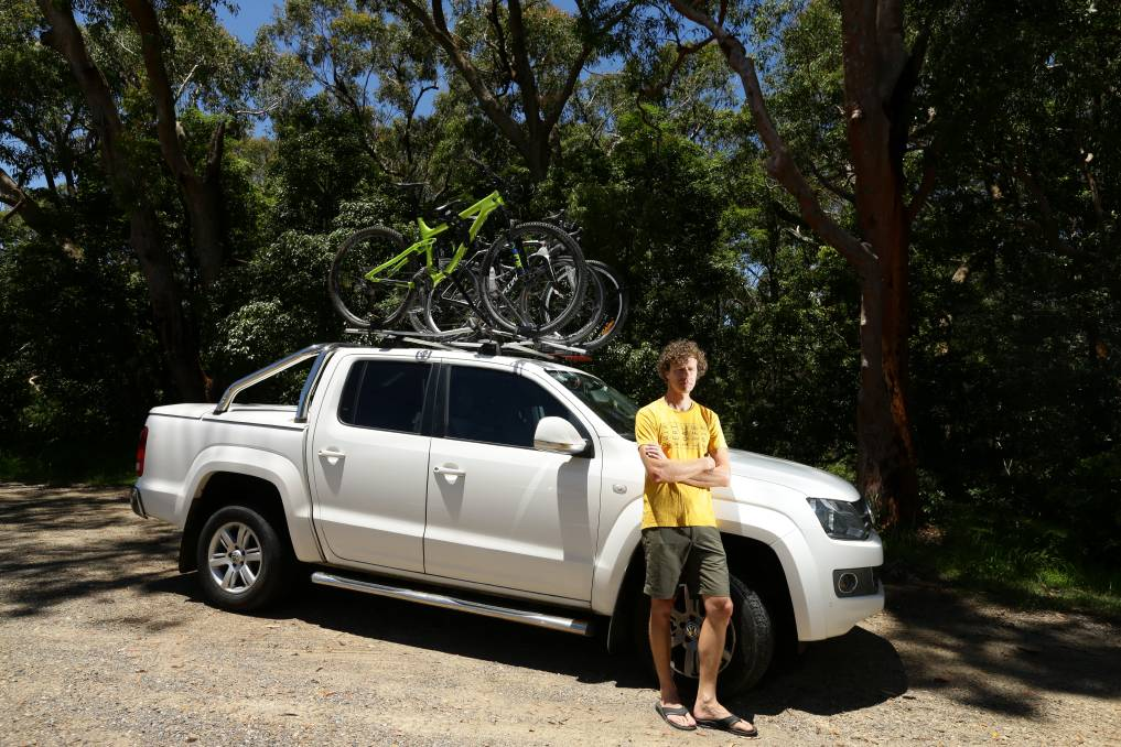 TOLL ON TOP: Tim Haasnoot with his ute and bikes on the roof, which has led to higher charges for him on Sydney toll roads. Picture: Jonathan Carroll