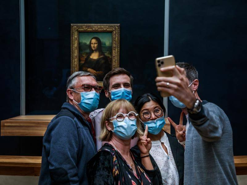 Visitors are able to again see Leonardo da Vinci's Mona Lisa, at the Louvre Museum in Paris.