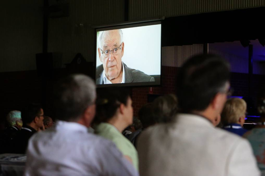 Synod attendees watch Reverend Bob Peattie in a video interview in which he reveals he was sexually abused as a child. Picture: Jonathan Carroll