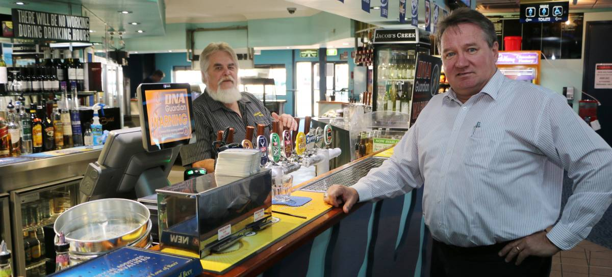 STRONG DETERRENT: Alex Moore with barman John Broadby at Munmorah United Bowling Club this week.  Picture: David Stewart