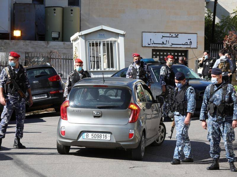 Lebanese police gather outside Baabda prison following the mass escape by inmates.