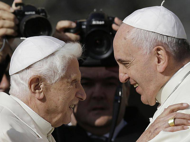 Emeritus Pope Benedict XVI (left) says there is only one pope and that it is Pope Francis (right).