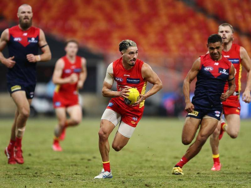Debutant Izak Rankine (C) has kicked three goals in Gold Coast's 17-point AFL loss to Melbourne.