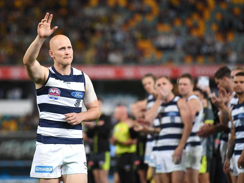 Gary Ablett waves goodbye as he exits the field after Geelong's AFL grand final defeat to Richmond.