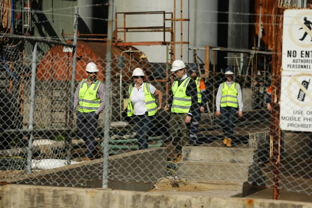 NSW Environment Minister Matt Kean and EPA chief executive officer Tracy Mackey (both centre) at the former Truegain site on Friday. Picture: Jonathan Carroll