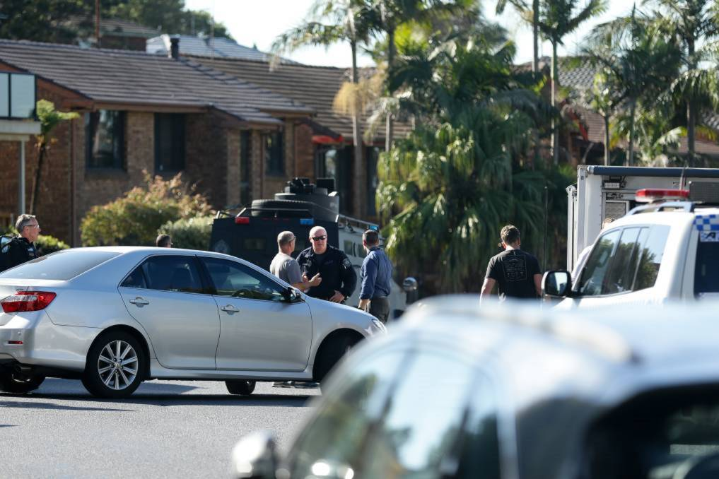 STAND OFF: Police outside the home at Maryland after the siege in July last year. Kaillin James Clancy has pleaded guilty to a string of offences, including shooting at police. Picture: Jonathan Carroll